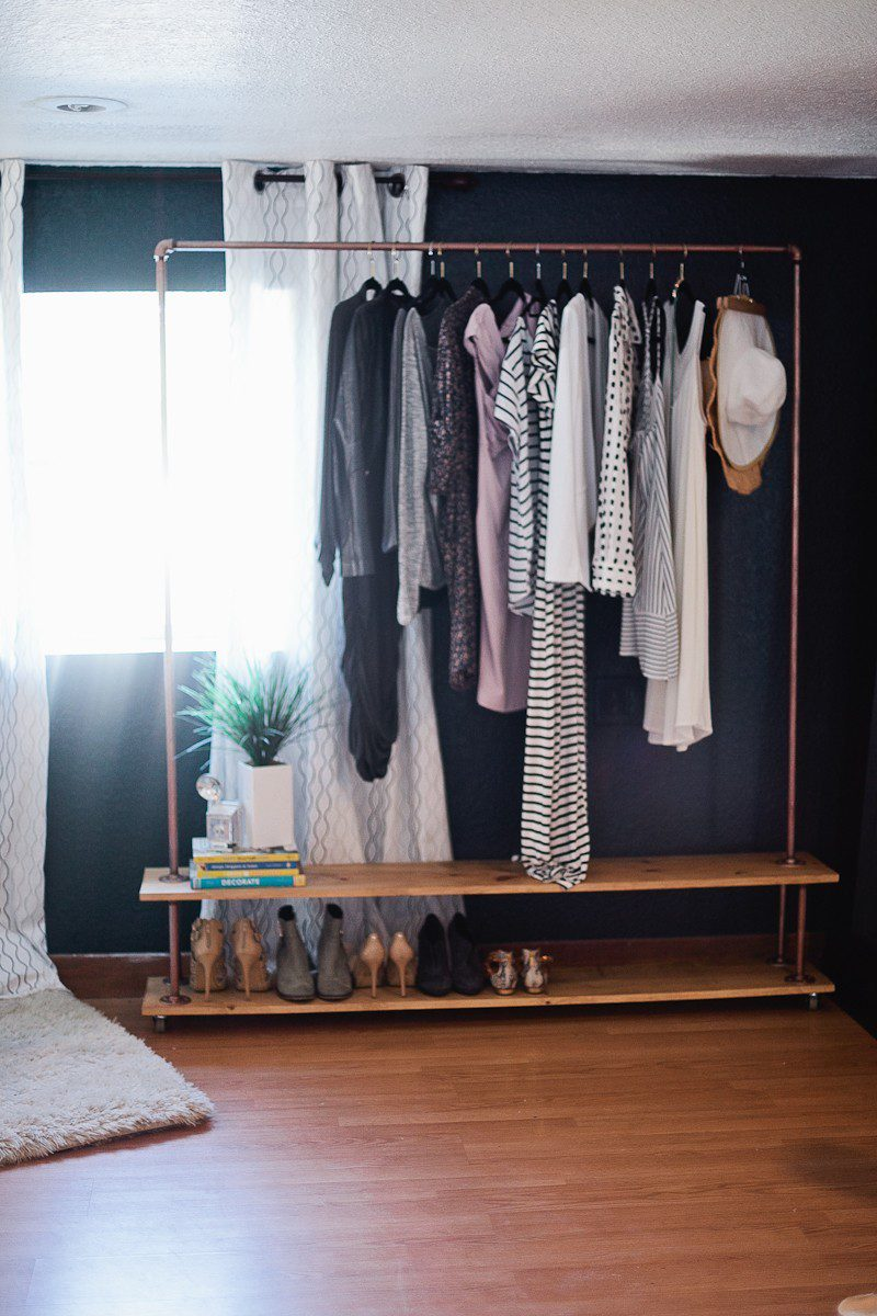 No closet? No problem. Create a DIY garment rack to take care of all of your clothes! This tutorial even shows how to add an extra shelf for storage and shoes!