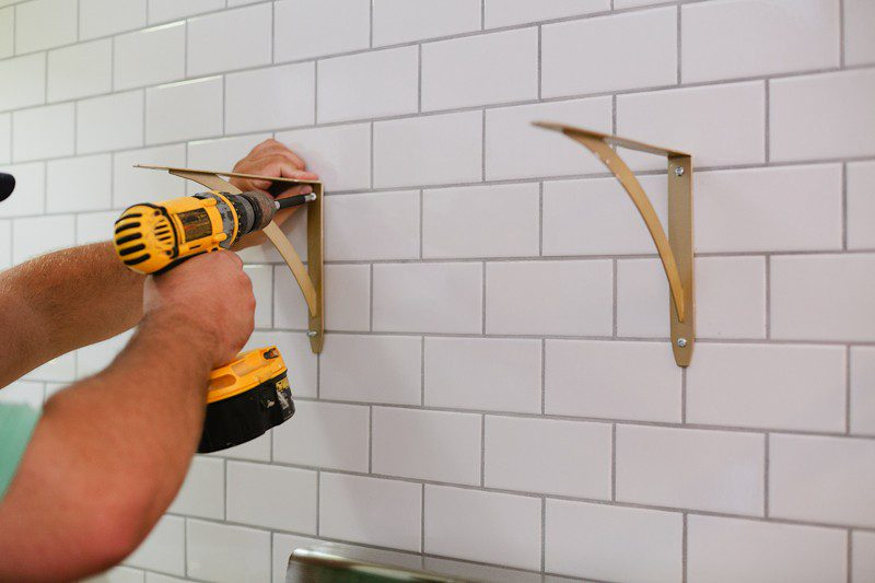 How to hang open shelving on tile (the easy way). A DIY step by step tutorial that you NEED to see before you get started featured by popular Florida lifestyle blogger Fresh Mommy Blog