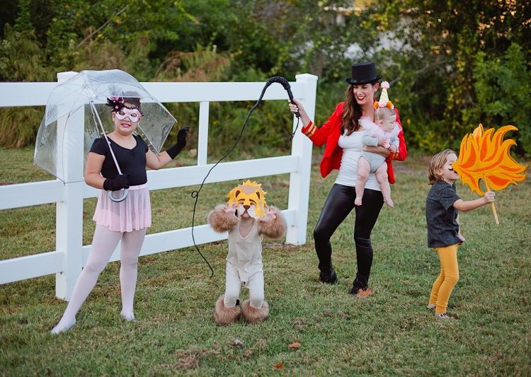 A DIY Family Circus Costume complete with Strong Man, Lion Tamer - Ring Master, Lion, Acrobat, Fire Breather and Clown! featured by popular Florida lifestyle blogger Fresh Mommy Blog | Cute Halloween Family Costume Ideas featured by top Florida lifestyle blogger, Fresh Mommy Blog: Family Circus