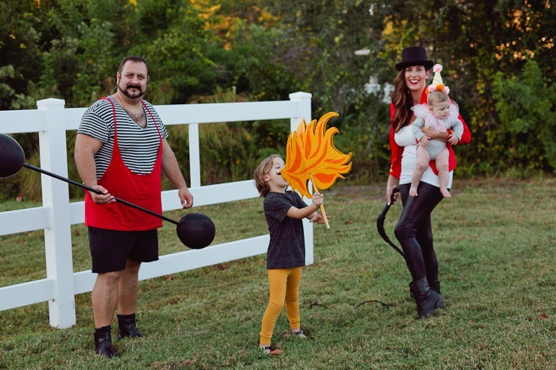 A DIY Family Circus Costume complete with Strong Man, Lion Tamer - Ring Master, Lion, Acrobat, Fire Breather and Clown! Get the full step by step on this family costume from popular Florida lifestyle blogger Tabitha Blue of Fresh Mommy Blog   Cute Halloween Family Costume Ideas featured by top Florida lifestyle blogger, Fresh Mommy Blog: Family Circus