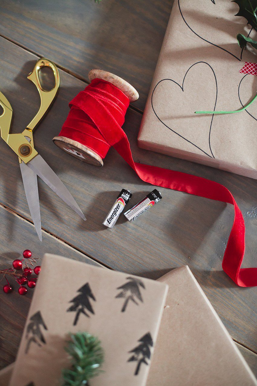 Save time and money with this easy and simple Christmas gift wrap hack! Gift wrapping ideas you can't miss, like using a potato to stamp your customized design.    The Simple and Easy Christmas Gift Wrapping Ideas You Can't Miss feeatured by top Florida life and style blog Fresh Mommy Blog