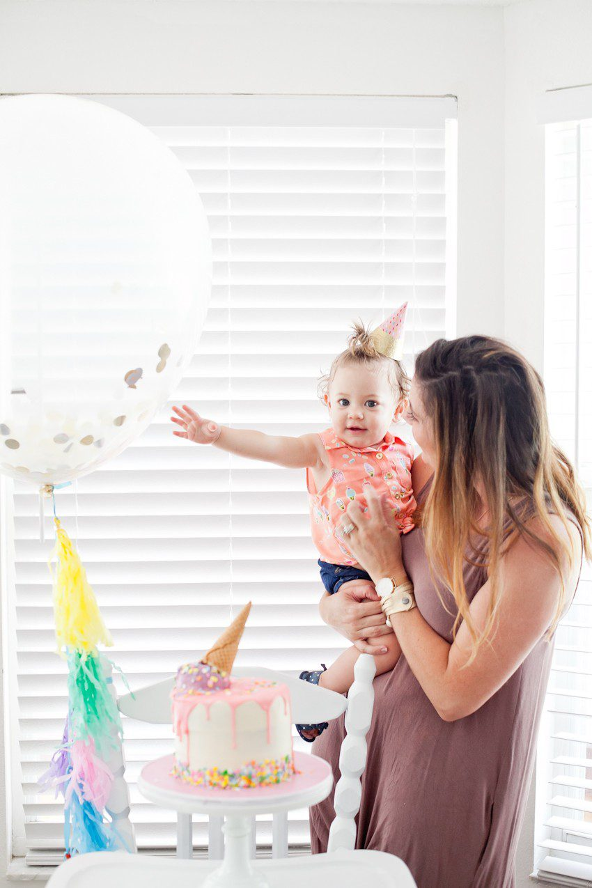 """Ice Cream Social Birthday Party with DIY Ice Cream Balloons, and ice cream cone """"spilled"""" cake, Ice Cream bar with cookies for DIY ice cream cookies and more! So much sweetness for a sweet first birthday party!"""