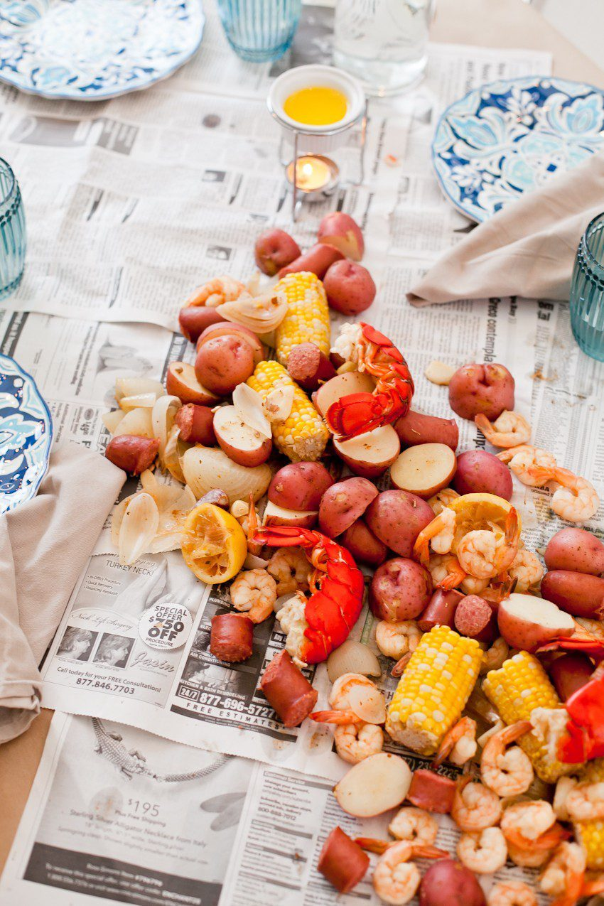 How to host a seafood boil for easy summer entertaining! Think a seafood boil seems like a lot of effort to pull off? We did too... until our first one! Read on for our simple tips to create your own summer seafood affair.   Grilling Season by popular Florida lifestyle blog, Fresh Mommy Blog: image of a seafood broil.