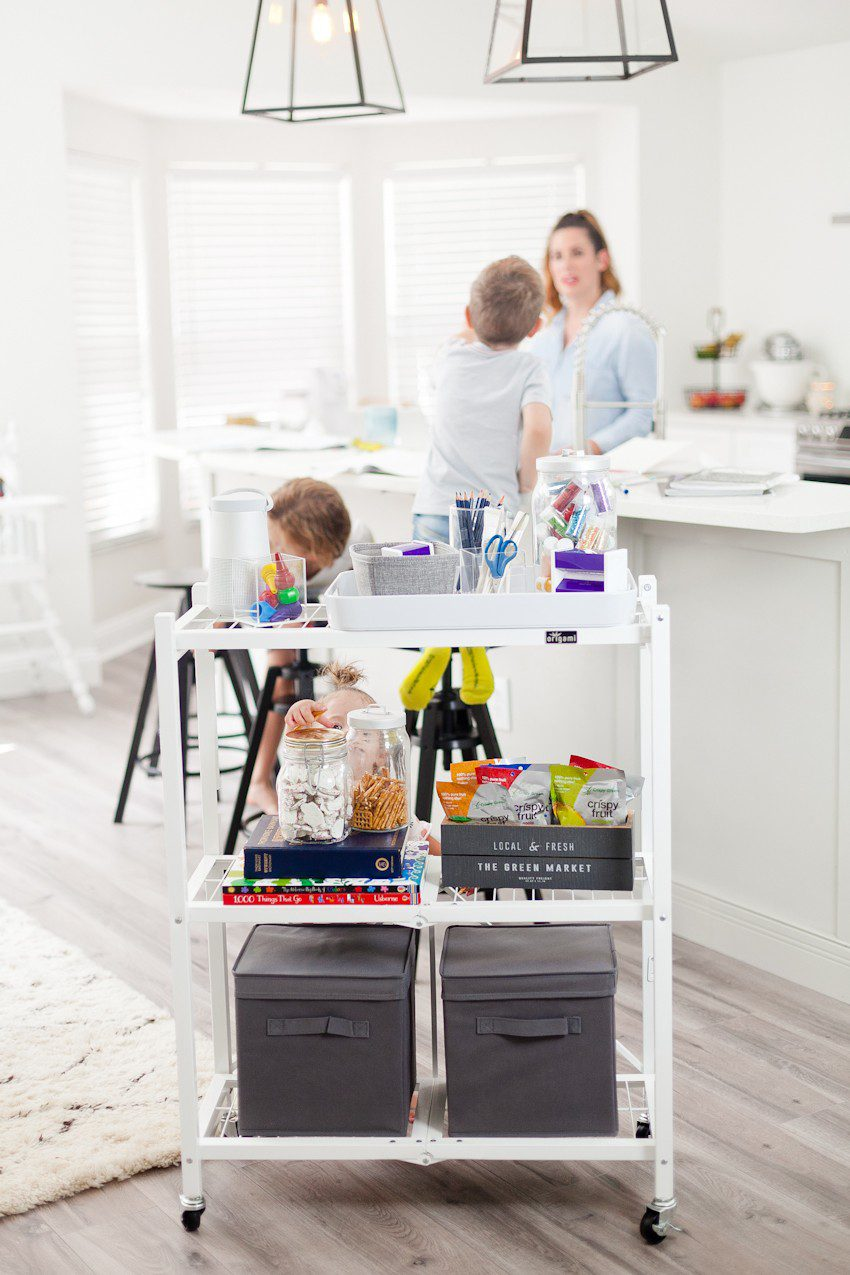 Prep for a clutter free school season with this portable DIY homework station! Makes a perfect craft station too, and rolls out of the way when finished. | How to Get Ready for School: 5 Sensational Strategies to Make Easy on your Family by popular Tampa life and style blog, Fresh Mommy: image of homework cart.