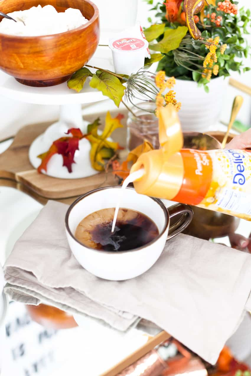 Easy at-home pumpkin pie spice latte recipe in this fall styled coffee bar cart and waffle brunch.