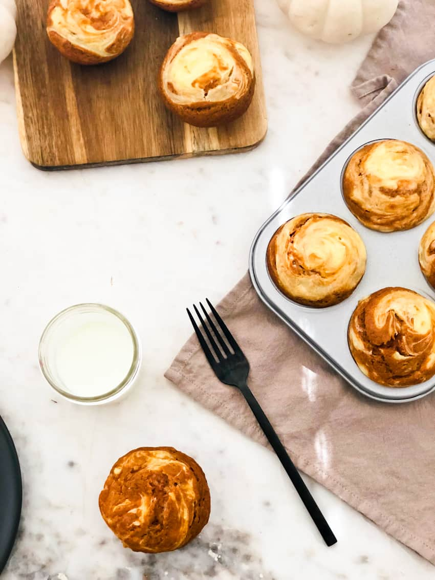 Enjoy the seasonal fall flavors with this quick and easy way to get breakfast on the table with our Pumpkin Cream Cheese Muffins! Moist, spiced pumpkin muffins with a swirl of sweet cream cheese to fuel up for the day... or anytime!