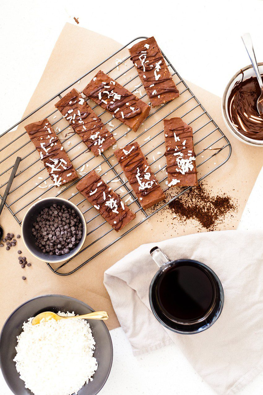 Simple 5 ingredient mocha no bake protein bars, flavored with coffee and chocolate and filled with good-for-you protein. Perfect for a morning on the run, an afternoon pick me up, or frozen for dessert they taste like a mocha fudge ice cream bar!