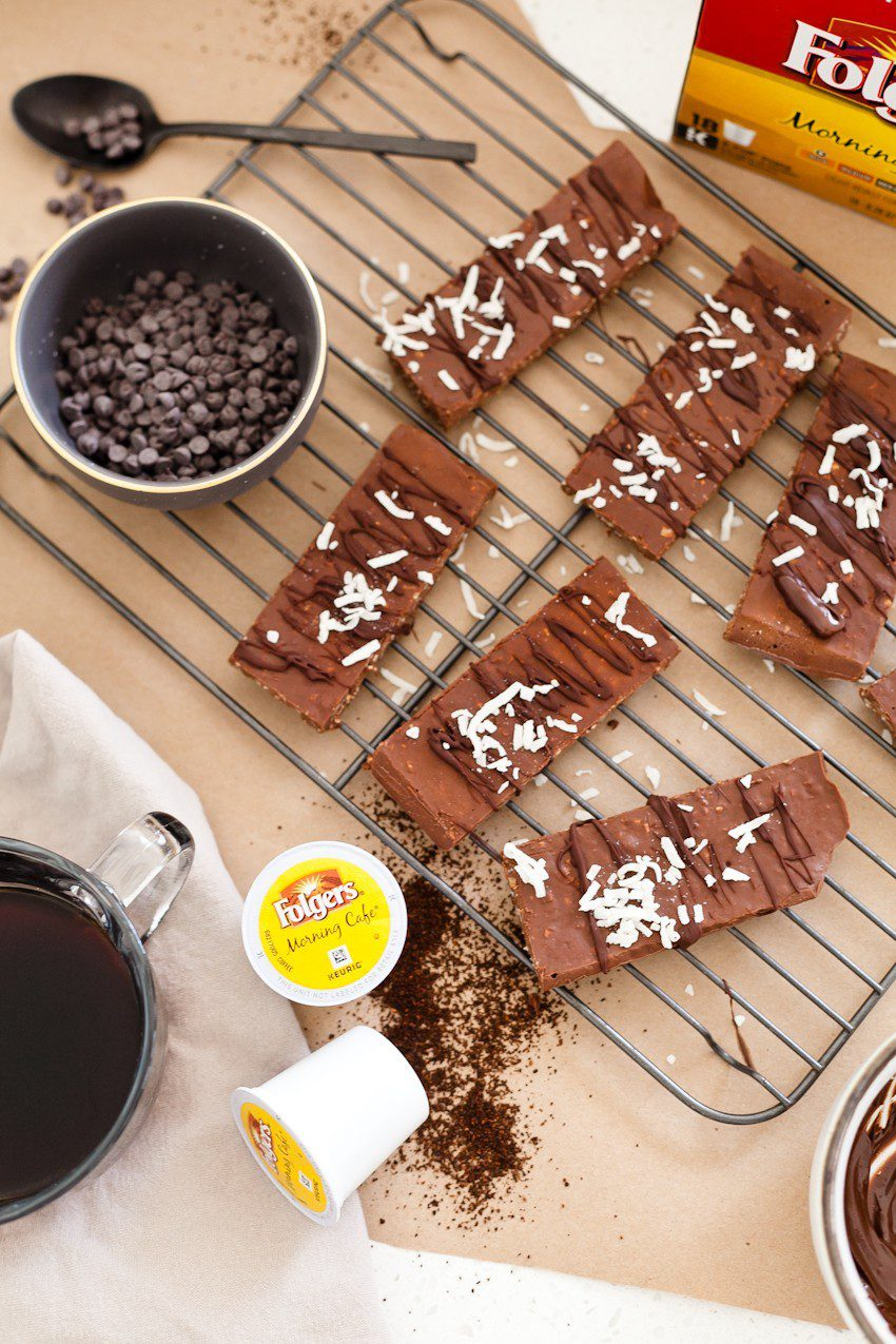 Simple 5 ingredient mocha no bake protein bars, flavored with coffee and chocolate and filled with good-for-you protein. Perfect for a morning on the run, an afternoon pick me up, or frozen for dessert they taste like a mocha fudge ice cream bar! - Mocha No Bake Protein Bars by popular Florida blogger Fresh Mommy Blog