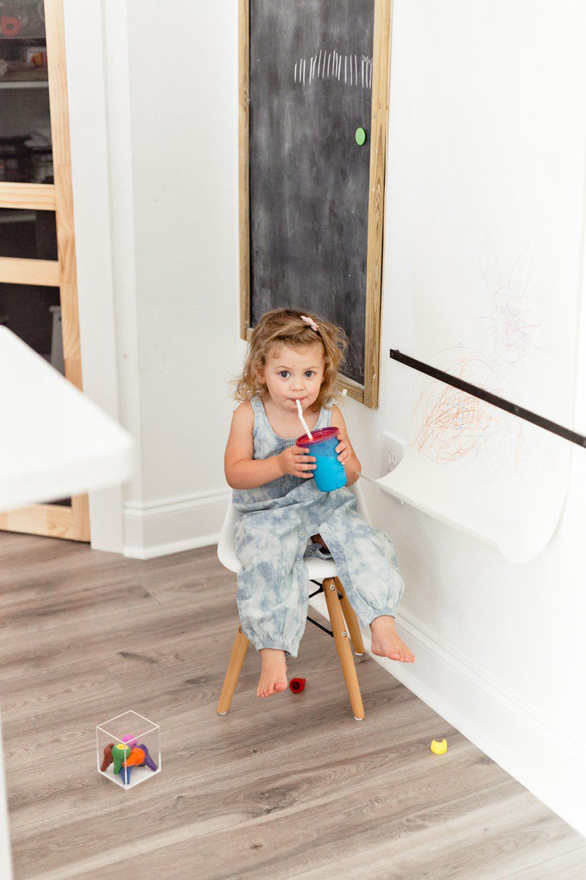 DIY coloring wall with hanging paper roll and magnetic chalkboard for kids and hours of entertainment! A family friendly on wall craft idea by popular Florida lifestyle blogger Tabitha Blue of Fresh Mommy Blog.
