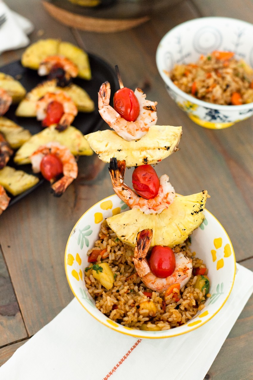 shrimp and pineapple skewers with pineapple fried rice   Grilling Season by popular Florida lifestyle blog, Fresh Mommy Blog: image of shrimp kabobs with cherry tomatoes and pineapple slices.