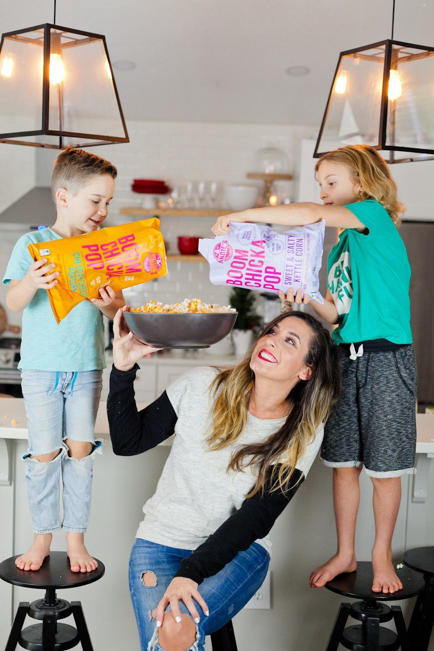 Easy Snacks on the Go for your Family with Boom Chicka Pop featured by top US lifestyle blog, Fresh Mommy Blog: image of a family eating Boom Chicka Pop popcorn