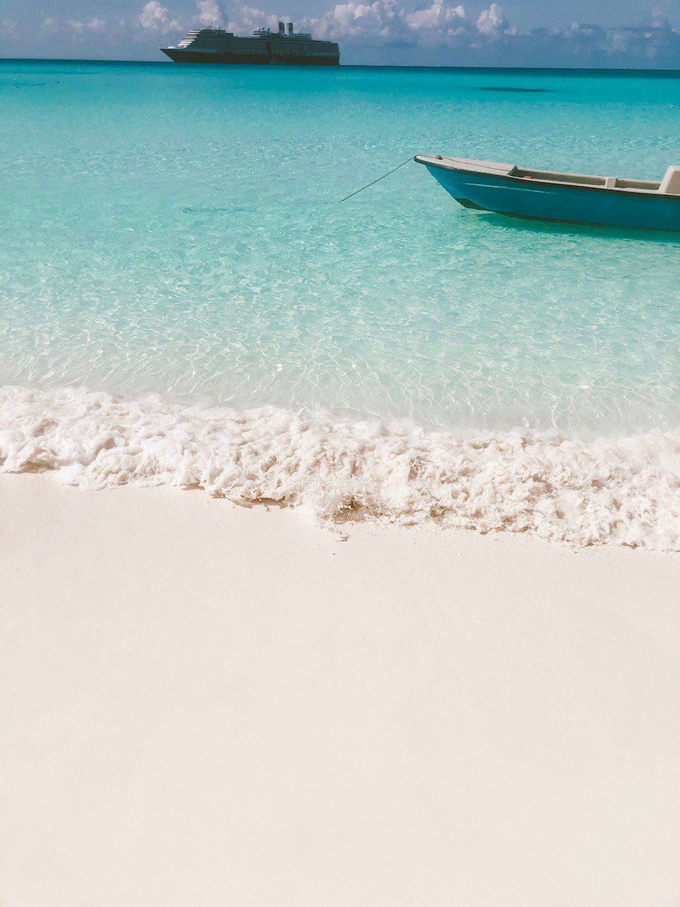 5 Amazing Reason to go on a Holland America cruise with Oprah Magazine by popular US lifestyle blog Fresh Mommy Blog: image of Holland America cruise ship in the Caribbean ocean.