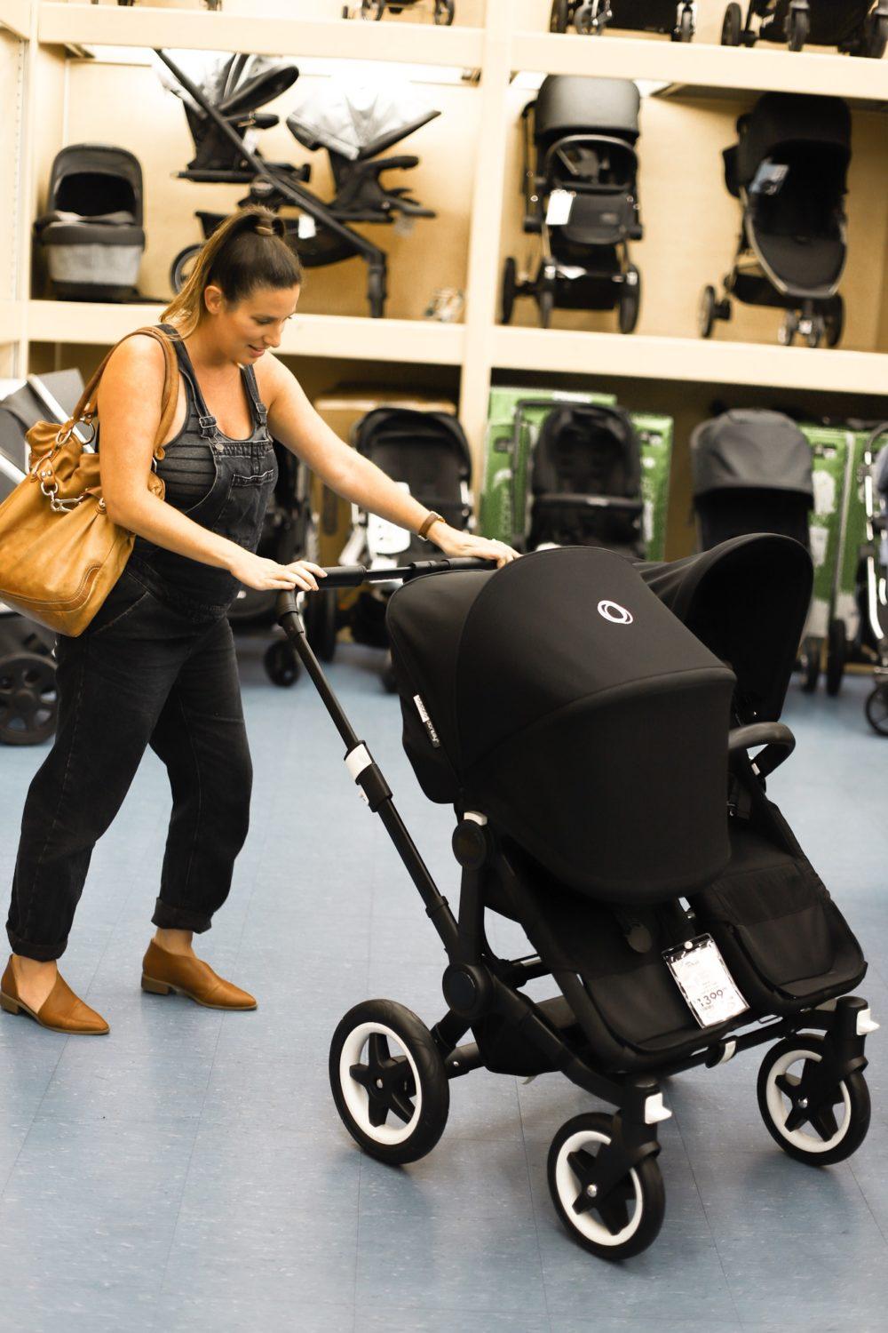 Our Twin Registry Essentials and Must Haves - Splurge vs Steal for bassinet for twins, twin pack n play, twin strollers and more by top US lifestyle blogger, Tabitha Blue of Fresh Mommy Blog | Baby Registry Must-Have for Twins by popular US mom blog, Fresh Mommy Blog: image of a pregnant woman testing a Baby Jogger® City Mini® Double Stroller at buybuy Baby.