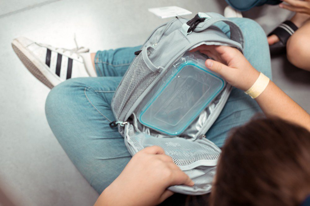 5 Sensational Strategies to Make Getting Ready for School Easy | How to Get Ready for School: 5 Sensational Strategies to Make Easy on your Family by popular Tampa life and style blog, Fresh Mommy: image of a kid looking in to a lunch kit.