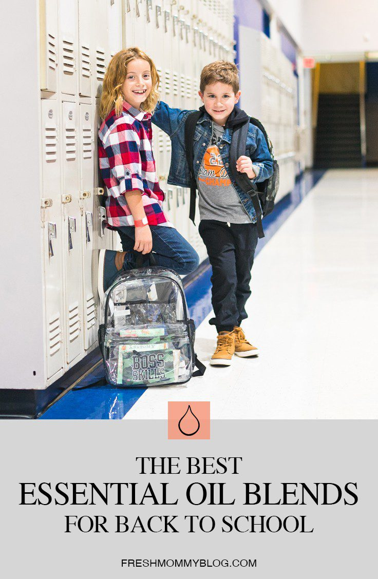 The Best Smelling and Most Effective Essential Oil Blends for Back to School! From helping with focus, to curbing lice and germs, we're sharing all the ways to use essential oils for back to school. From Popular Florida Lifestyle blogger Tabitha Blue of Fresh Mommy Blog. | Best Smelling Back to School Essential Oils by popular Florida life and style blog, Fresh Mommy: Pinterest image of two boys standing in a school hallway and leaning against a row of white lockers.