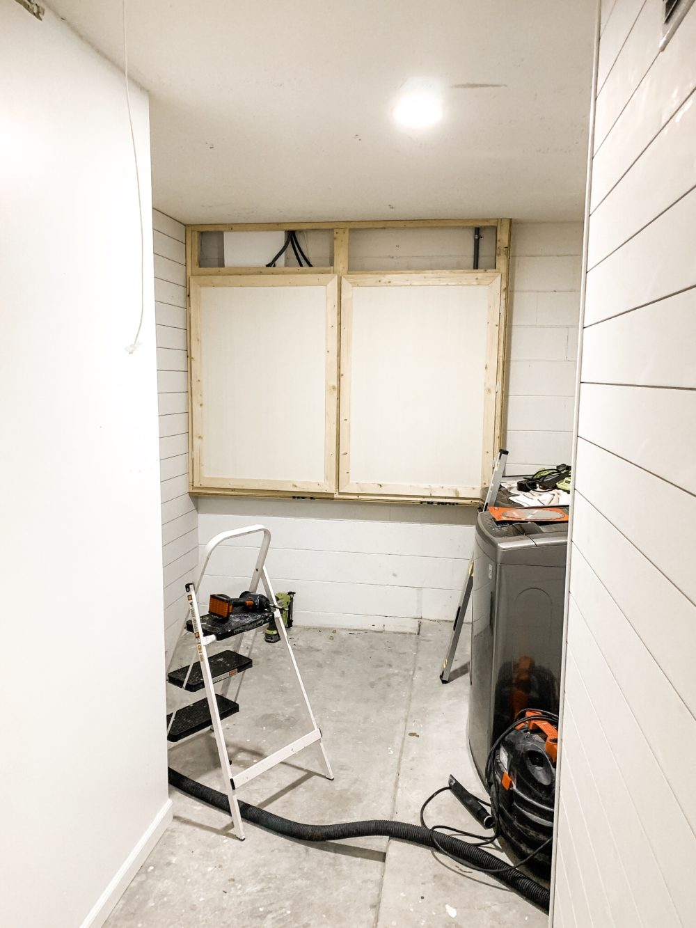 DIY for Covering Breaker Boxes: A Faux Cabinet Tutorial by popular Florida DIY blog, Fresh Mommy: image of handmade cabinets covering some utility boxes.