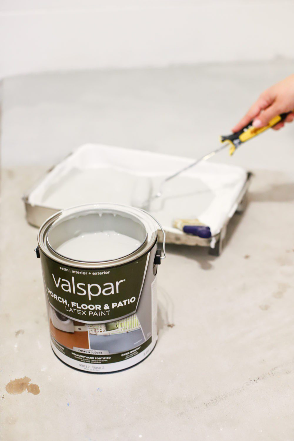 Laundry Room DIY: How to Paint a Cement Floor with Stencils | Laundry Room DIY: How to Paint a Cement Floor with Stencils by popular home decor blog, Fresh Mommy: image of Valspar porch and floor paint, paint pan, and paint roller.