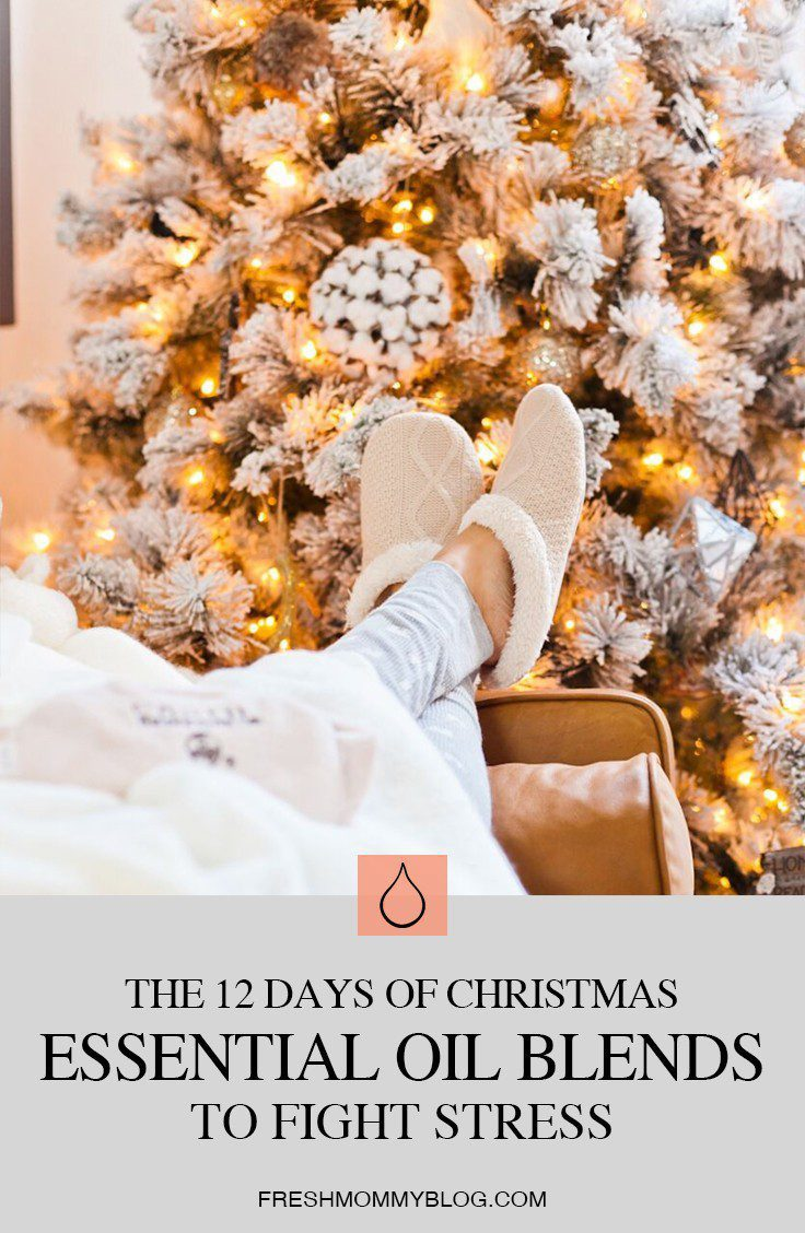 12 Christmas Essential Oils to Fight Stress by popular Florida life and style blog, Fresh Mommy: image of a woman lounging on a couch in front of a flocked Christmas tree.
