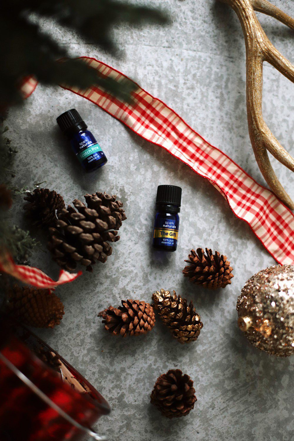 12 Days of Christmas Essential Oils   12 Christmas Essential Oils to Fight Stress by popular Florida life and style blog, Fresh Mommy: image of Spark Naturals Scotch Pine and The Gift essential oils.