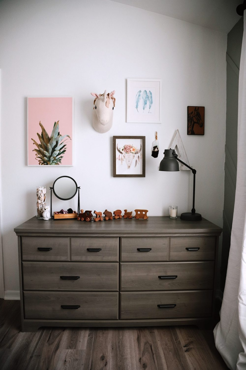 Shared girls' room design with DIY accent wall with one of Valspar's 12 new colors of the year for 2020, Secret Moss. For their 12 shades for 2020, Valspar sought to bring the tranquility of nature into a room to create naturally therapeutic, serene spaces. I love how this dusky moss green (with a hint towards gray) creates a calming escape in our girls' room. We went with one of Valspar's 12 new colors of the year for 2020, Secret Moss. For their 12 shades for 2020, Valspar sought to bring the tranquility of nature into a room to create naturally therapeutic, serene spaces. I love how this dusky moss green (with a hint towards gray) creates a calming escape in our girls' room. We went with one of Valspar's 12 new colors of the year for 2020, Secret Moss. For their 12 shades for 2020, Valspar sought to bring the tranquility of nature into a room to create naturally therapeutic, serene spaces. I love how this dusky moss green (with a hint towards gray) creates a calming escape in our girls' room. | Gorgeous Wood Feature Wall + Shared Girl's Room Update by popular Florida home decor blog, Fresh Mommy Blog: image of a shared girls' room decorated with a Lowe's South Shore Furniture Versa Gray Maple 6-Drawer Double Dresser, Lowe's LEVOLOR Trim+Go Shadow Light Filtering Cordless Solar Shade, Lowe's allen + roth 2-Pack Black Curtain Rod Finials, Lowe's Paint Paints & Primers Paint Samples Item # 1185292 Model # 5005-2A Valspar Secret Moss Interior Paint, Lowe's DAP DryDex 8-oz White Spackling, Lowe's allen + roth Matte Black 72-in To 144-in Matte Black Steel Single Curtain Rod, and Lowe's allen + roth LL WARWICK 42-IN x 84-IN TAUP PNL 84-in Taupe Polyester Blackout Thermal Lined Single Curtain Panel.