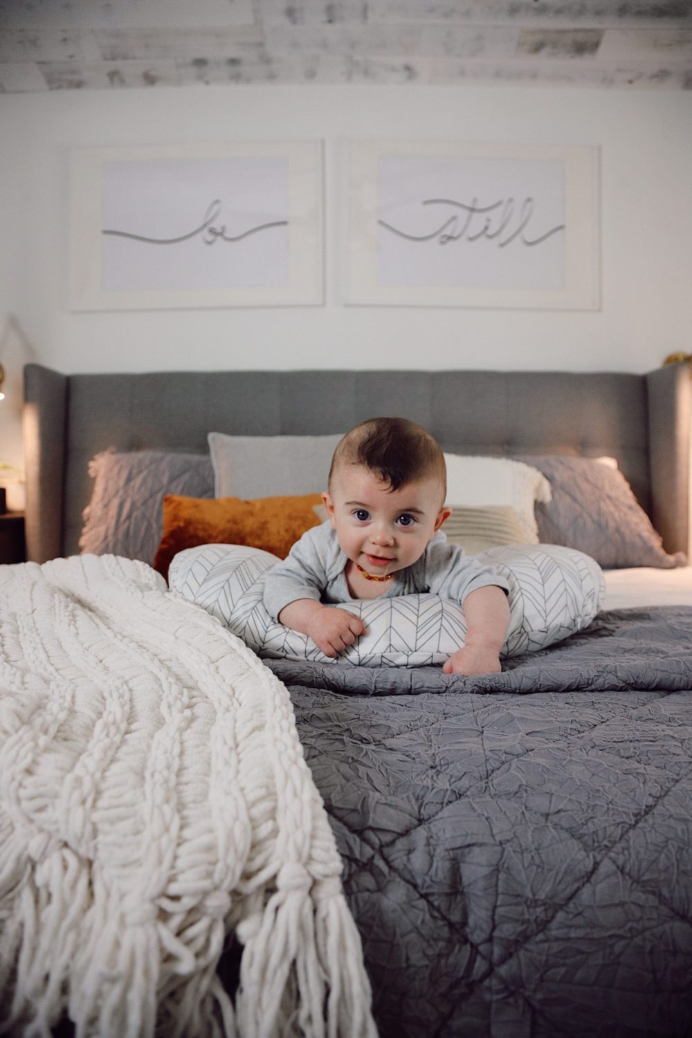 how to Make your Bed Comfortable Like a Hotel in 7 Easy Steps, a tutorial featured by top Florida lifestyle blog, Fresh Mommy Blog. Cutest baby on the cosiest bed. Lennon Blue | Best Bedding by popular Florida life and style blog, Fresh Mommy: image of a comfortable bed with a baby laying on it's stomach on top of it.
