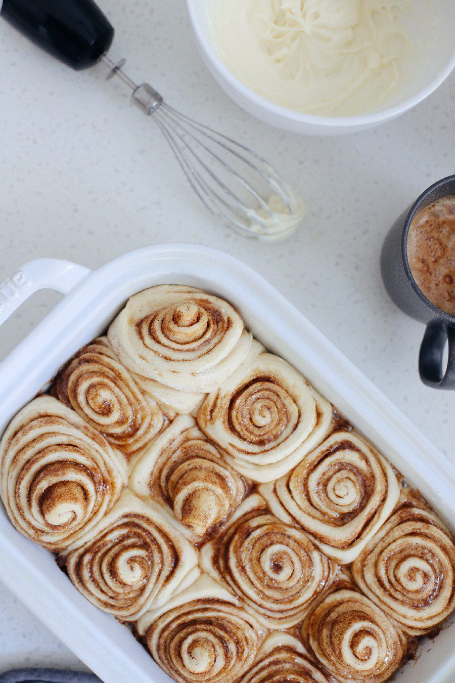 Easy bread machine cinnamon rolls dough. The best gooey sticky buns and clone of a Cinnabon roll icing! NO waiting overnight. Click for the recipe and how to video for fluffy cinnamon rolls homemade with a bread maker machine! Use all purpose flour or make them gluten free. Recipe from top Florida lifestyle blogger Tabitha Blue of Fresh Mommy Blog.