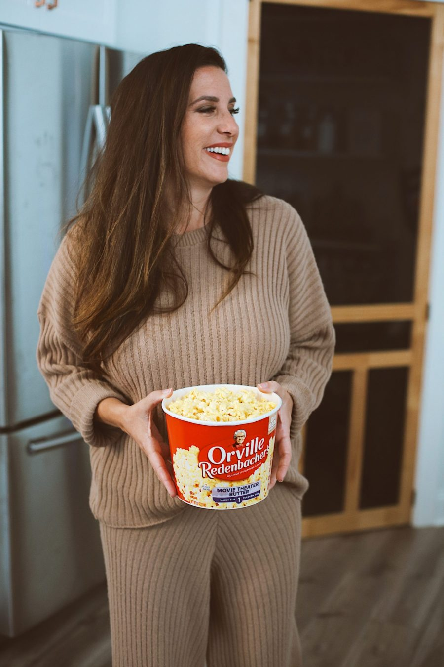10 Popcorn Games for a Great Family Fun Night | Family Fun Night by popular Florida lifestyle blog, Fresh Mommy Blog: image of Tabitha Blue holding a container of ORville Redenbacher's movie theater popcorn.
