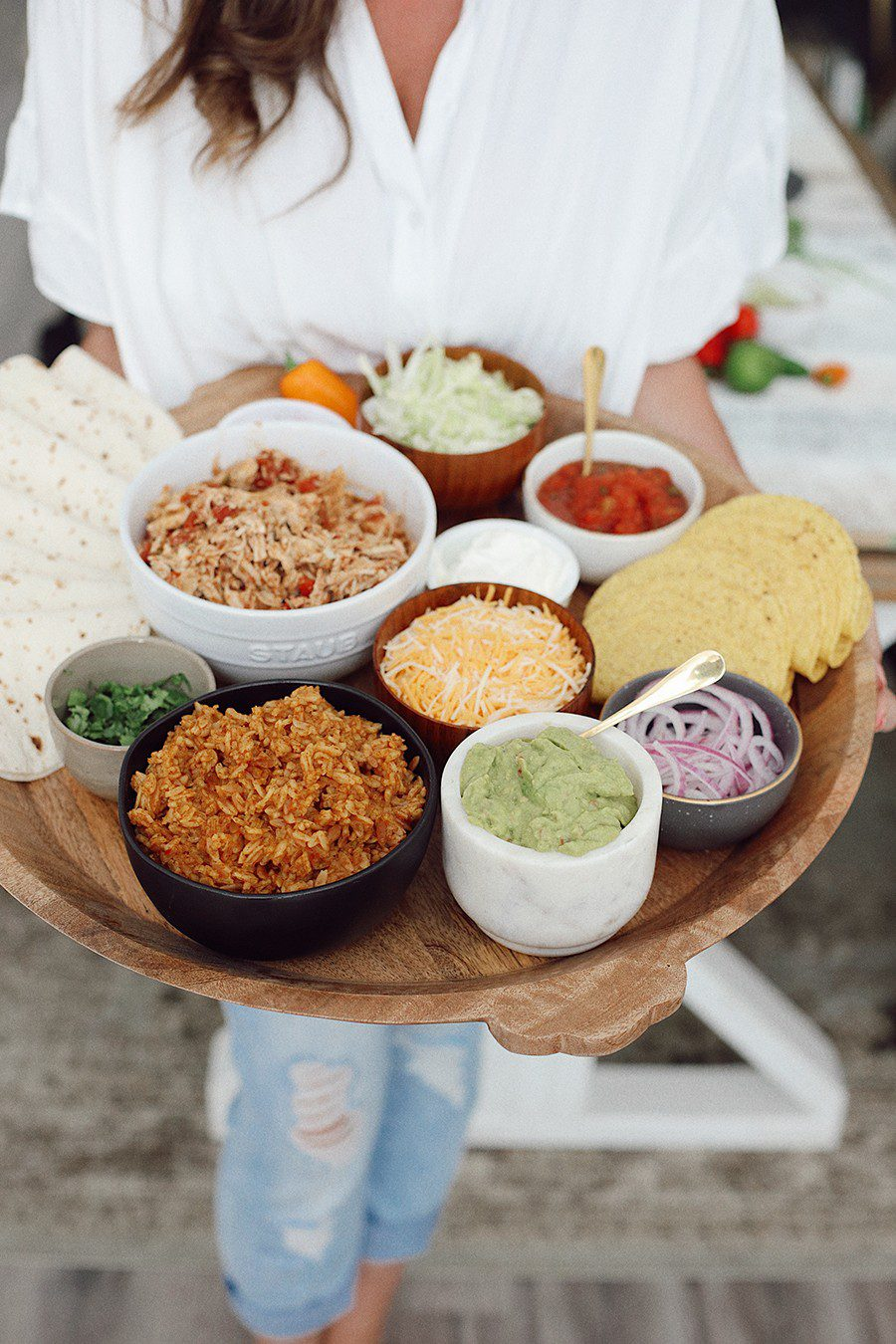 Slow Cooker Chicken Taco Board | Chicken Tacos by popular Florida lifestyle blog, Fresh Mommy Blog: image of Tabitha Blue holding a Chicken Tacos platter.