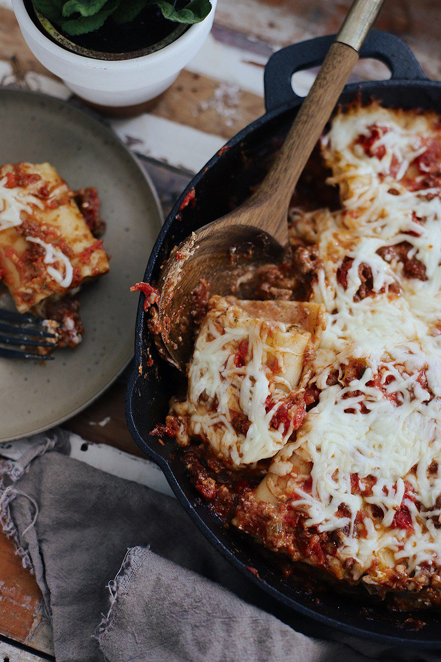 The Ultimate Cast Iron Lasagna with this lodge cast iron recipe from top Florida lifestyle blogger Tabitha Blue of Fresh Mommy Blog! Cast iron skillet cooking with kids to get family dinner on the table in 30 minutes!
