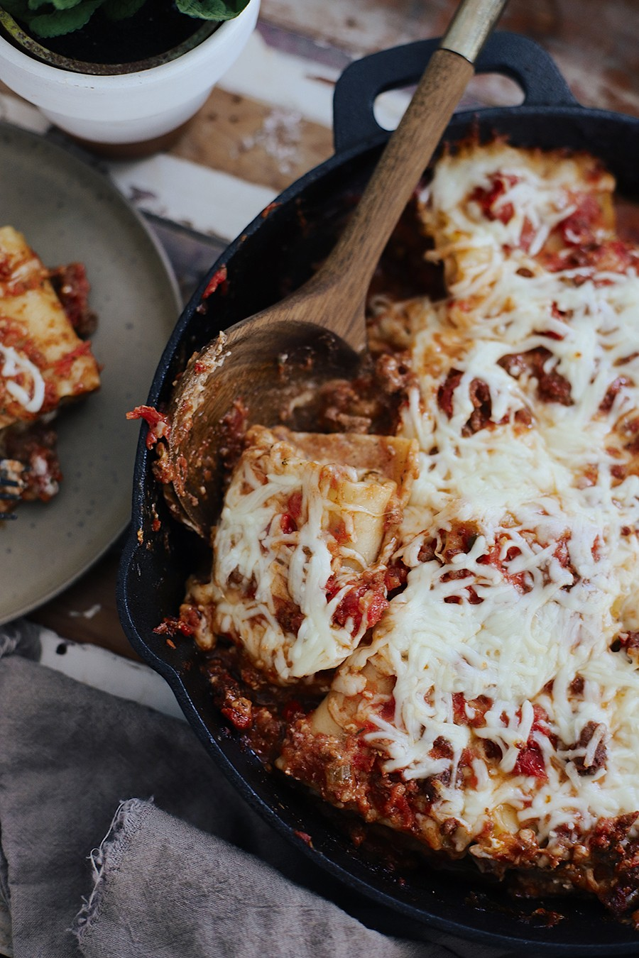 The Ultimate Cast Iron Lasagna with this lodge cast iron recipe from top Florida lifestyle blogger Tabitha Blue of Fresh Mommy Blog! Cast iron skillet cooking with kids to get family dinner on the table in 30 minutes! | Cast Iron Lasagna by popular Florida lifestyle blog, Fresh Mommy Blog: image of cast iron lasagna.