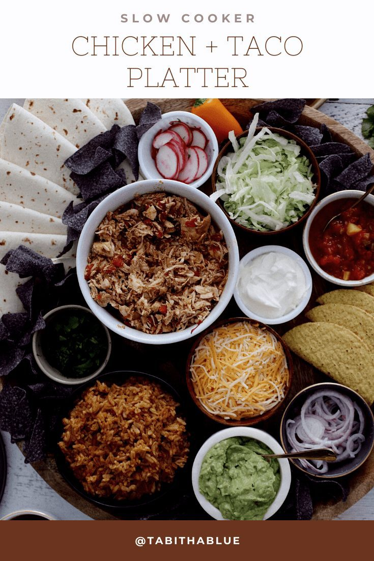 How to make an epic taco board and taco party platter tips! Plus, the best slow cooker taco chicken recipe! | Chicken Tacos by popular Florida lifestyle blog, Fresh Mommy Blog: Pinterest image of chicken tacos platter.