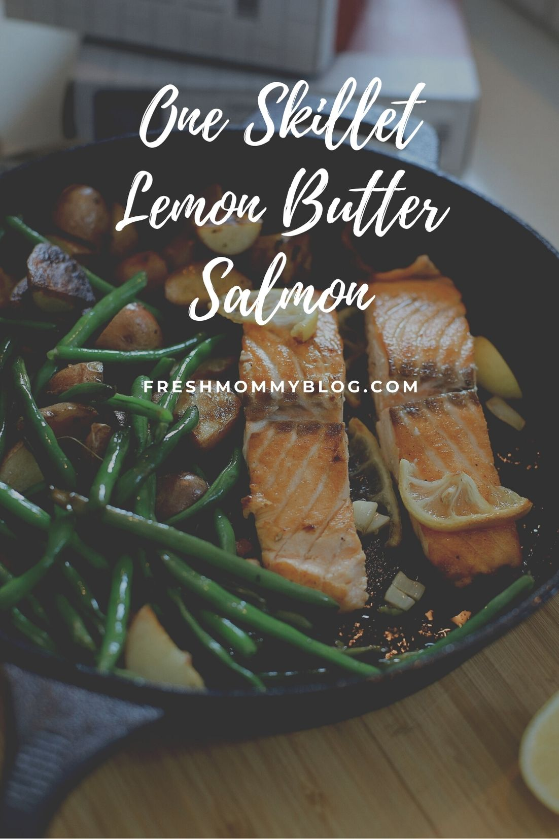 One Pan Salmon Skillet with Garlic Lemon Butter | Salmon Skillet by possible Florida lifestyle blog, Fresh Mommy Blog: image of salmon, green beans, and potatoes in a skillet.