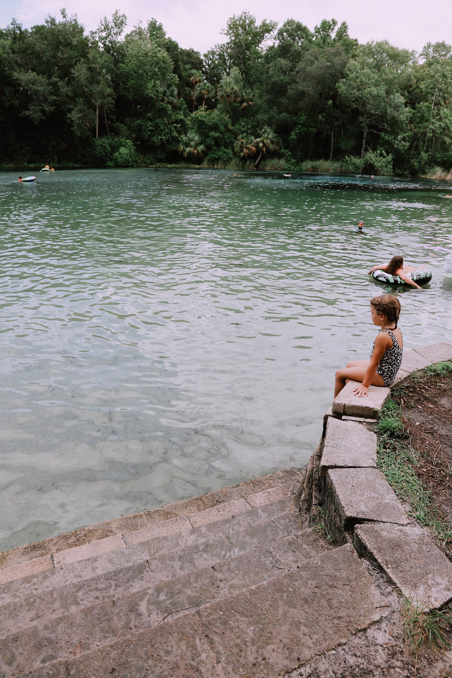 Spectacular Lake County, Florida Staycation Ideas for the Family! Alexander Springs Recreation Area   Lake County by popular Florida blog, Fresh Mommy Blog: image of a family swimming at Alexander Springs Recreation Area.