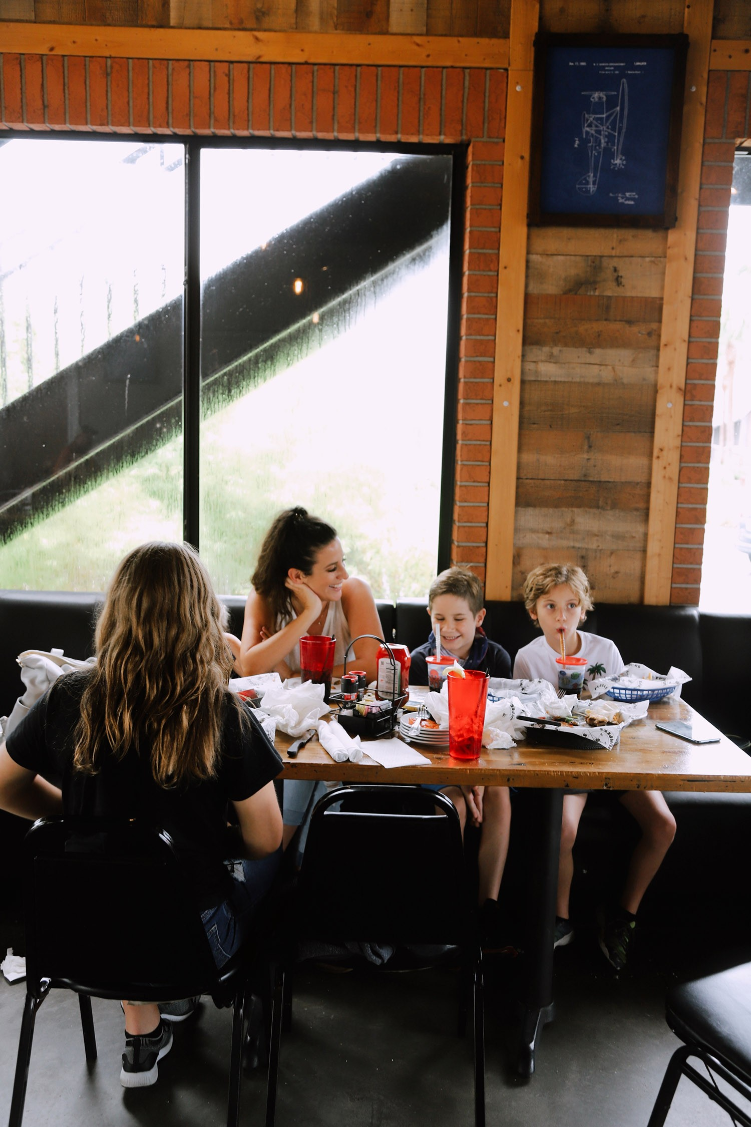 Spectacular Lake County, Florida Staycation Ideas for the Family!   Lake County by popular Florida blog, Fresh Mommy Blog: image of a family eating food at Puddle Jumpers.