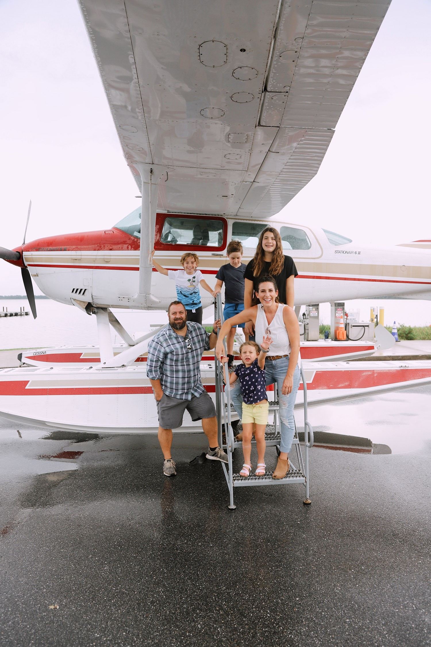 Spectacular Lake County, Florida Staycation Ideas for the Family! Jones Brothers Seaplane in Seaplane City   Lake County by popular Florida blog, Fresh Mommy Blog: image of a family standing next to a sea plane.