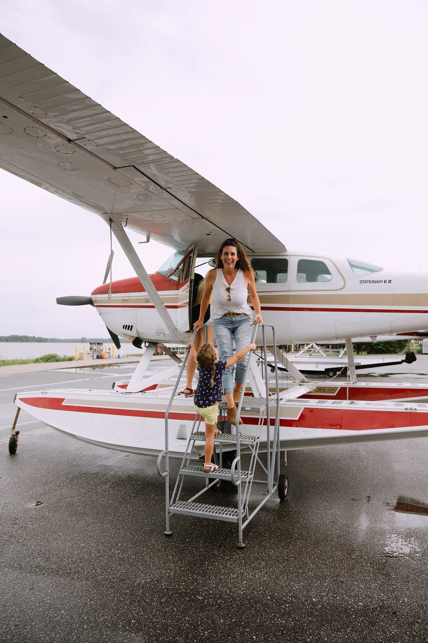 Spectacular Lake County, Florida Staycation Ideas for the Family!   Lake County by popular Florida blog, Fresh Mommy Blog: image of a mom and her young daughter standing next to a sea plane.