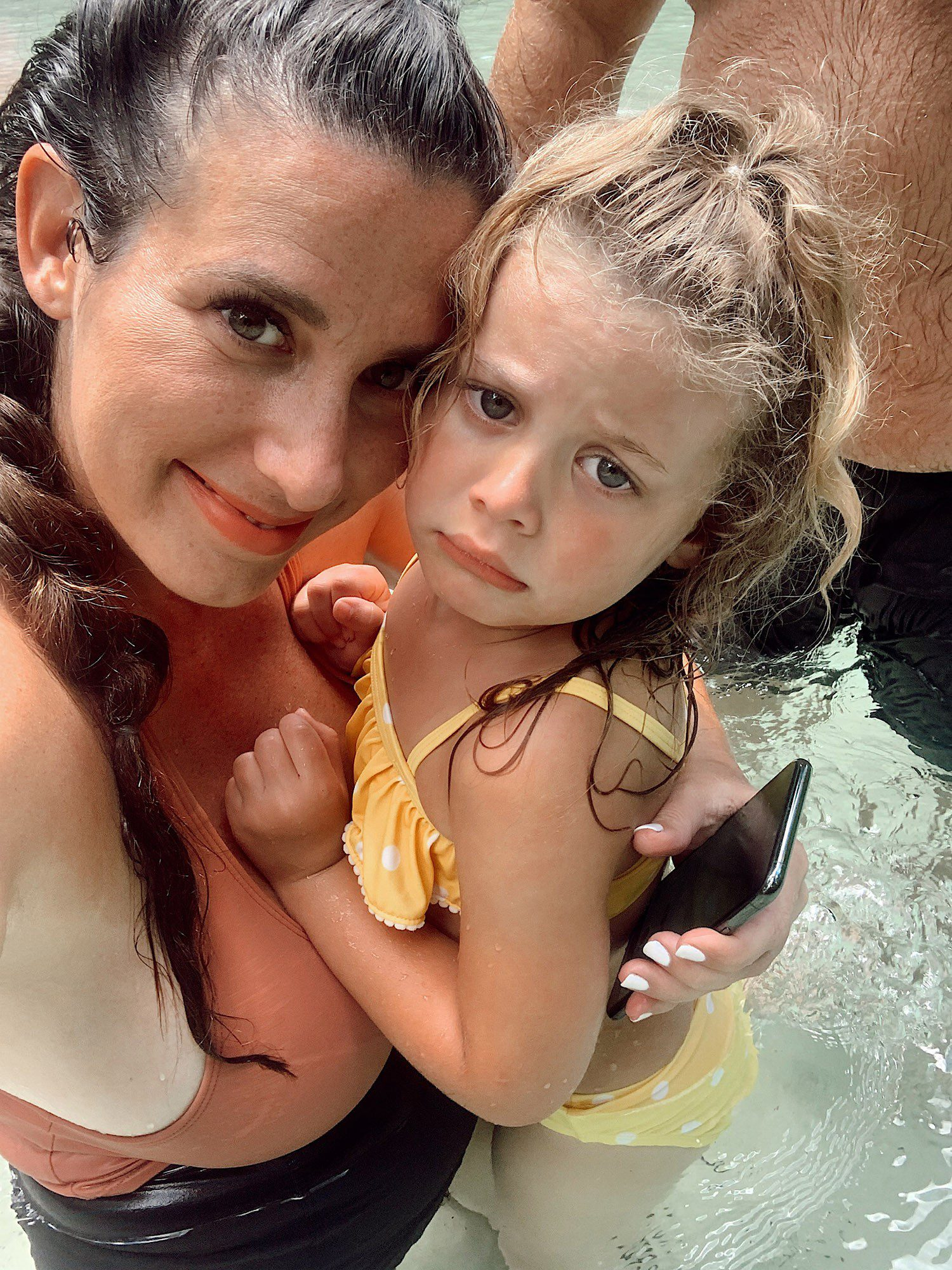 Tips for an Amazing Weeki Wachee Kayaking Florida Staycation. Visit Florida Travel ideas from top lifestyle blogger Tabitha Blue of Fresh Mommy Blog.   Weeki Wachee Kayaking by popular Florida blog, Fresh Mommy Blog: image of Tabitha Blue holding her young daughter as they stand in the water.