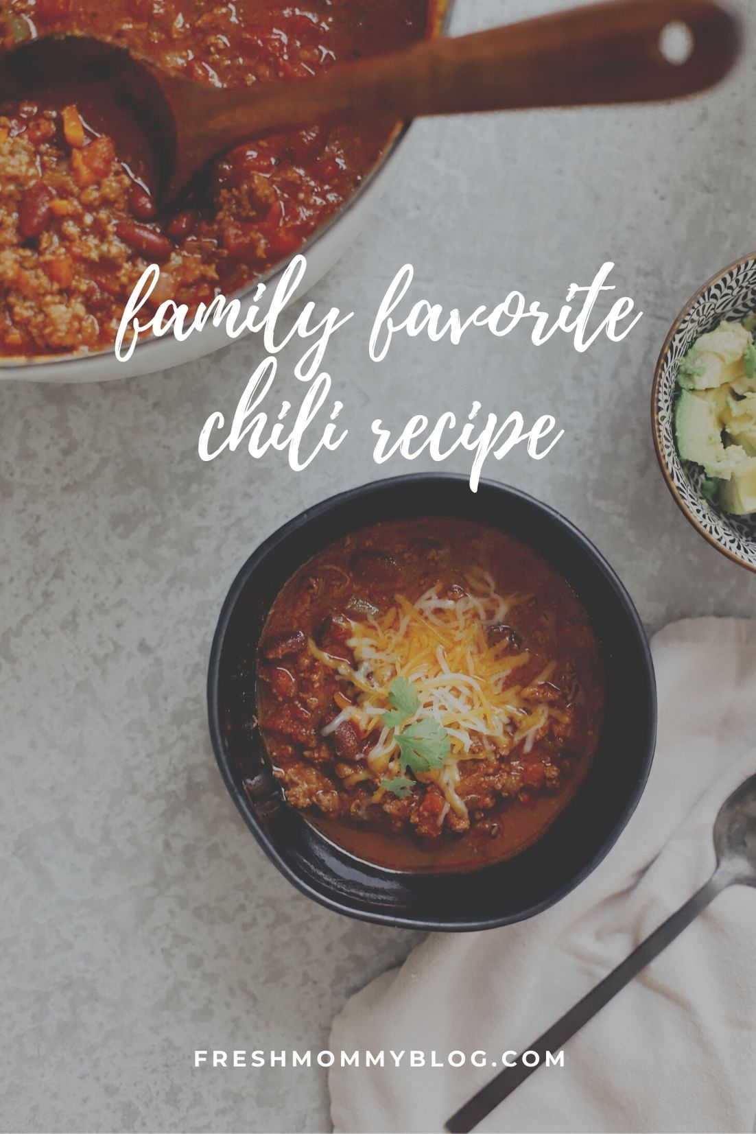 Easy Family Favorite Chili recipe! Make this delicious classic homemade chili in the crockpot or in one pot easily. It's THE BEST CHILI, and my family asks me to make it over and over. | Chili Recipe by popular Florida lifestyle blog, Fresh Mommy Blog: Pinterest image of chili in a black ceramic bowl with shredded cheese on top.