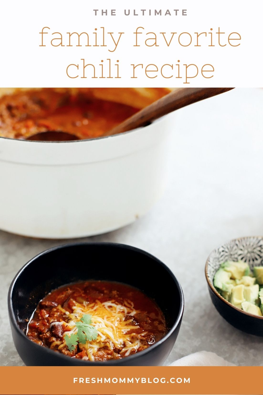Easy Family Favorite Chili recipe! Make this delicious classic homemade chili in the crockpot or in one pot easily. It's THE BEST CHILI, and my family asks me to make it over and over. | Chili Recipe by popular Florida lifestyle blog, Fresh Mommy Blog: Pinterest of chili in a black ceramic bowl with shredded cheese on top.