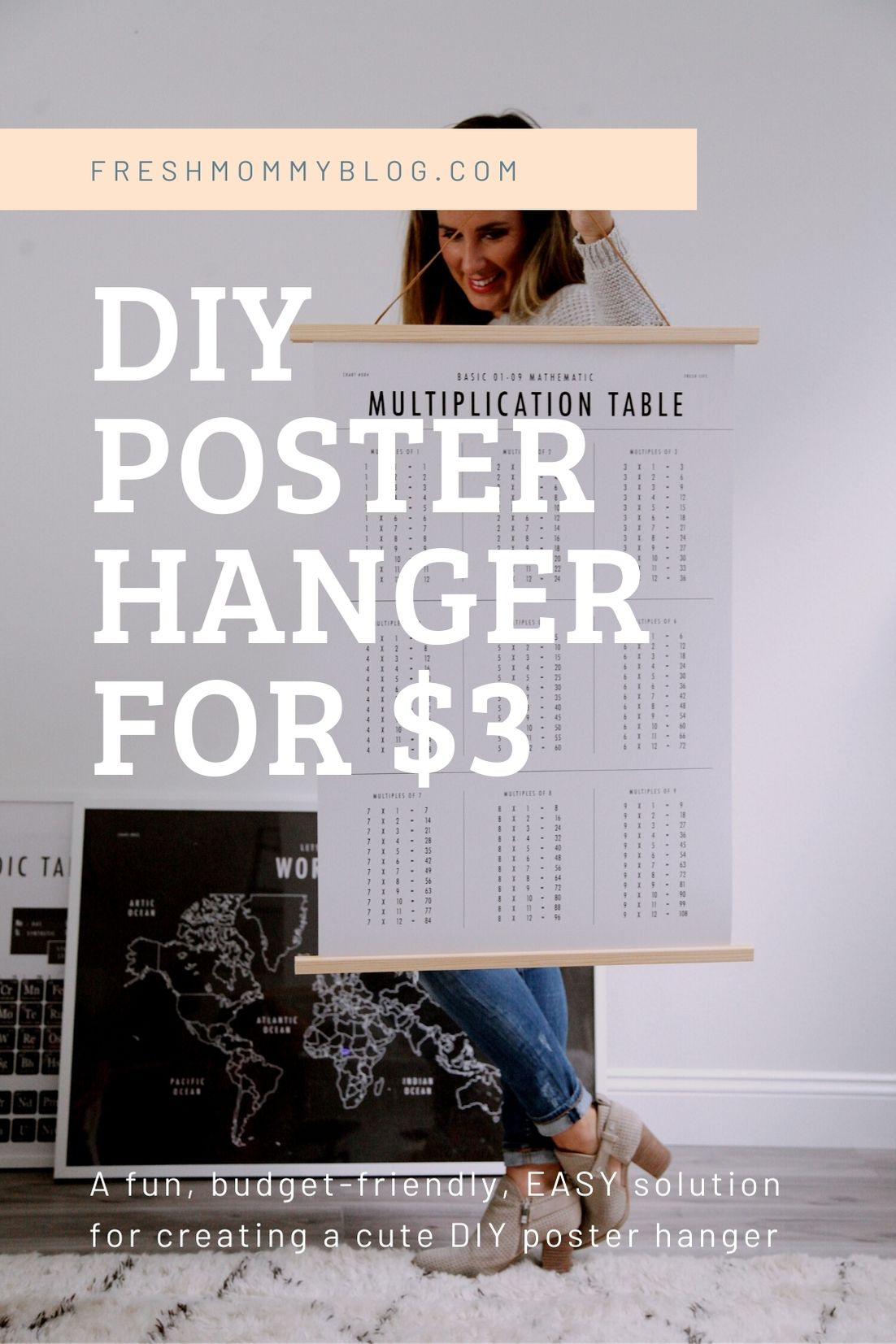 Click through for a fun, EASY DIY poster hanger tutorial. You can make your own  DIY poster hanger for $3 in just a few short minutes!   DIY Poster Hanger by popular Florida DIY blog, Fresh Mommy Blog: Pinterest image of Tabitha Blue holding a DIY poster hanger.