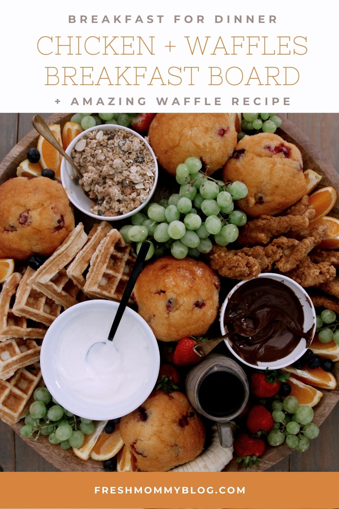 Easy Waffle Recipe for an Amazing Breakfast for Dinner Family Night - Chicken and Waffles Breakfast Board | Waffle Recipe by popular Florida lifestyle blog, Fresh Mommy Blog: image of a wooden board filled with waffles, muffins, grapes, strawberries, orange slices, granola, fried chicken, yogurt, and chocolate sauce.