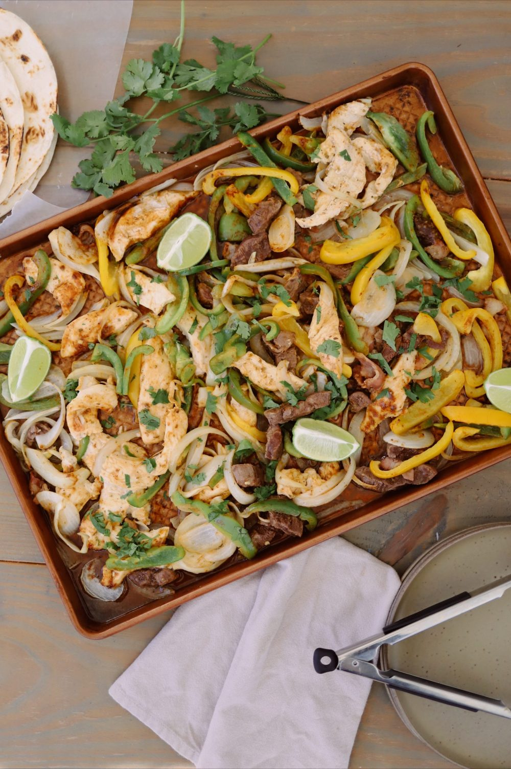 Steak and Chicken Fajitas: Sheet Pan Dinners for a Large Family from top US Lifestyle Blogger Tabitha Blue of Fresh Mommy Blog.