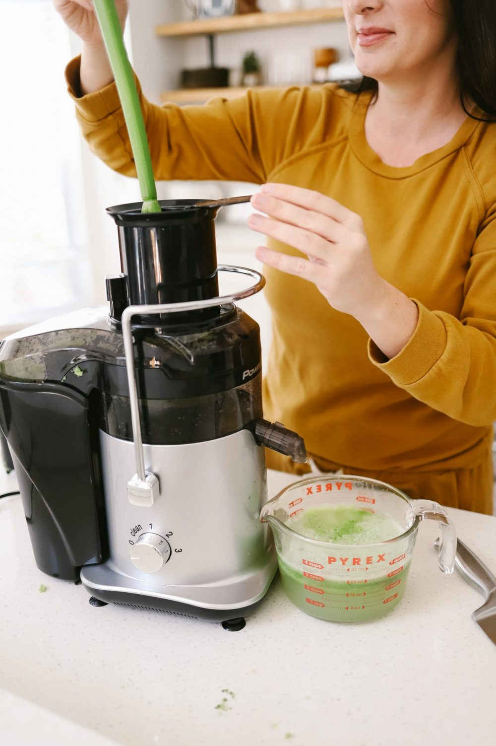 The Best Easy Clean Juicer Review for 2021: We tested easy clean juicers and this is what we found. Shown: PowerXL Self Cleaning Juicer. shown: Breville JE98XL Juice Fountain Plus Centrifugal Juicer  Easy Clean Juicer by popular Florida lifestyle blog, Fresh Mommy Blog: image of a woman making green juice in her easy clean juicer.