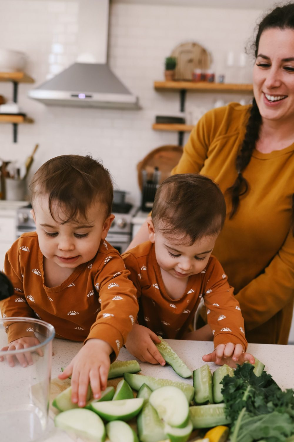 The Best Easy Clean Juicer Review for 2021: We tested easy clean juicers and this is what we found.  Easy Clean Juicer by popular Florida lifestyle blog, Fresh Mommy Blog: image of twin baby boys eating cucumbers.