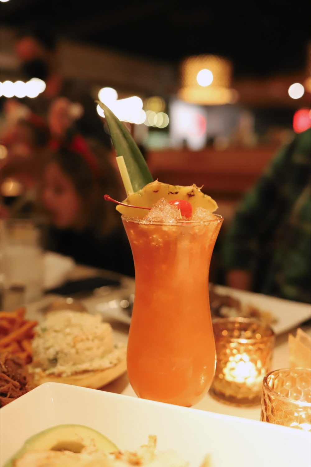 One of the Best Secret Winter Sun Destinations, Scottsdale Arizona. Family-friendly dinner at Hula's Modern Tiki |Guide by popular Florida travel blog, Fresh Mommy Blog: image of a tropical drink at Hula's Modern Tiki.