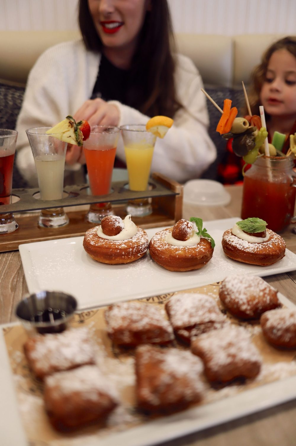 One of the Best Secret Winter Sun Destinations, Scottsdale Arizona. Family-friendly brunch at Hash Kitchen |Guide by popular Florida travel blog, Fresh Mommy Blog: image of Hash Kitchen donuts and drinks.