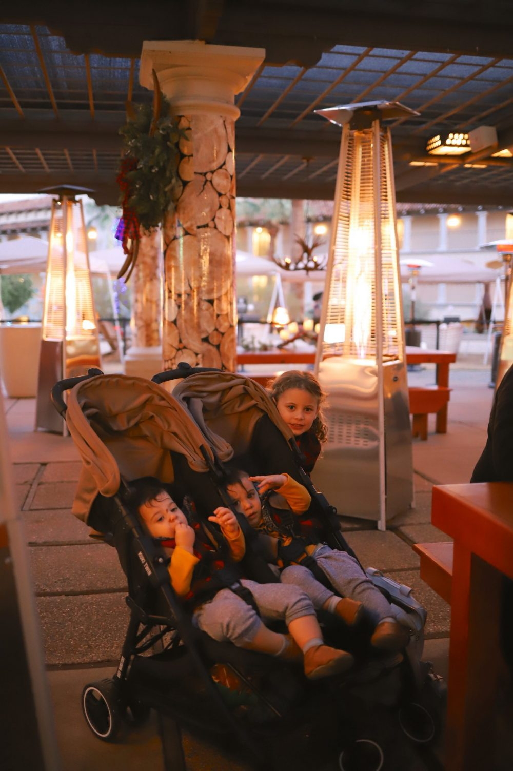 One of the Best Secret Winter Sun Destinations, Scottsdale Arizona. Family-friendly dinner at fun holiday pop up restaurant The Lodge at Scottsdale Christmas at the Princess |Guide by popular Florida travel blog, Fresh Mommy Blog: image of kids at The Lodge at Scottsdale Christmas at the Princess.
