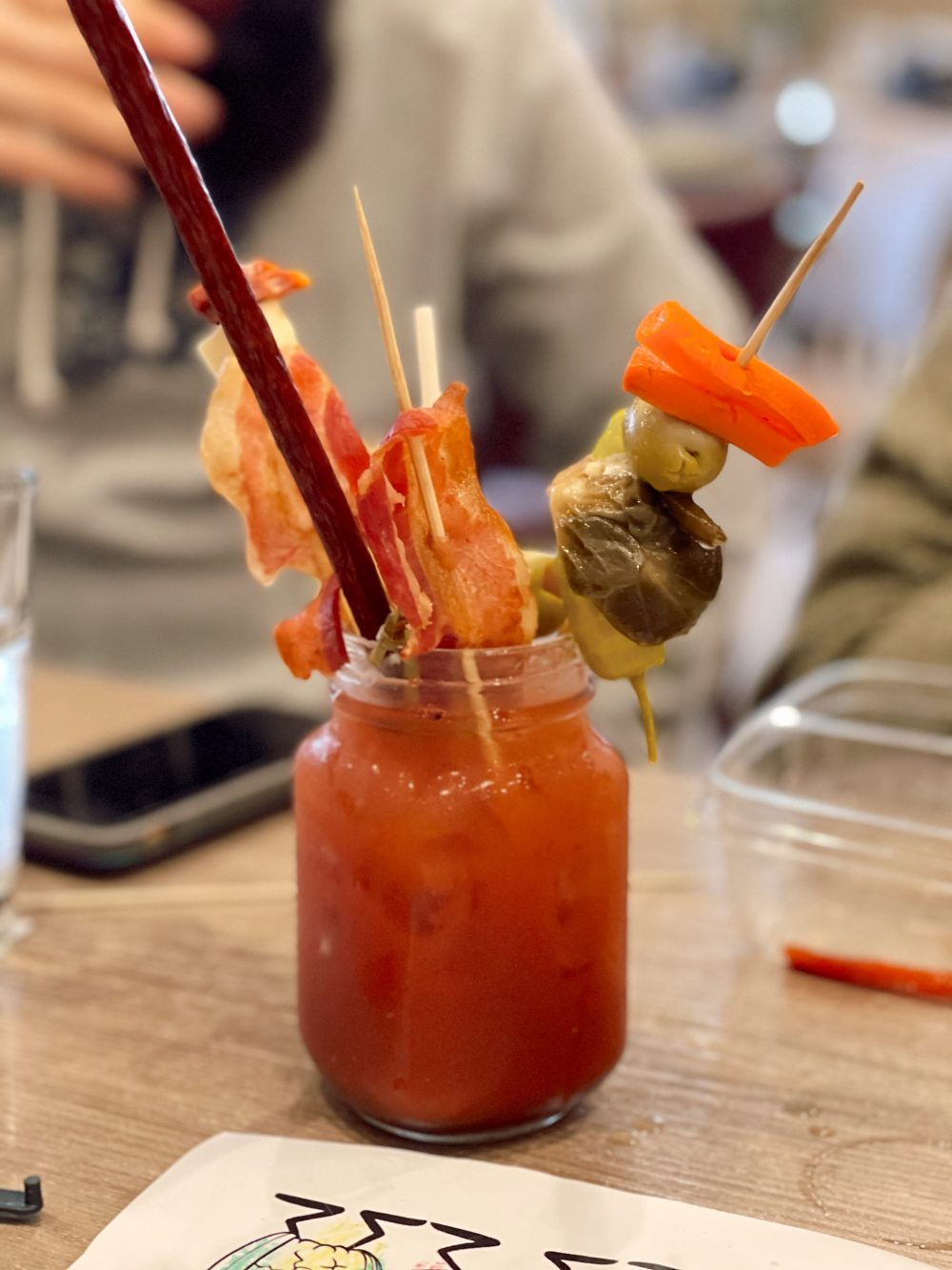 One of the Best Secret Winter Sun Destinations, Scottsdale Arizona. Family-friendly brunch at Hash Kitchen |Guide by popular Florida travel blog, Fresh Mommy Blog: image of a bloody mary drink at Hash Kitchen.