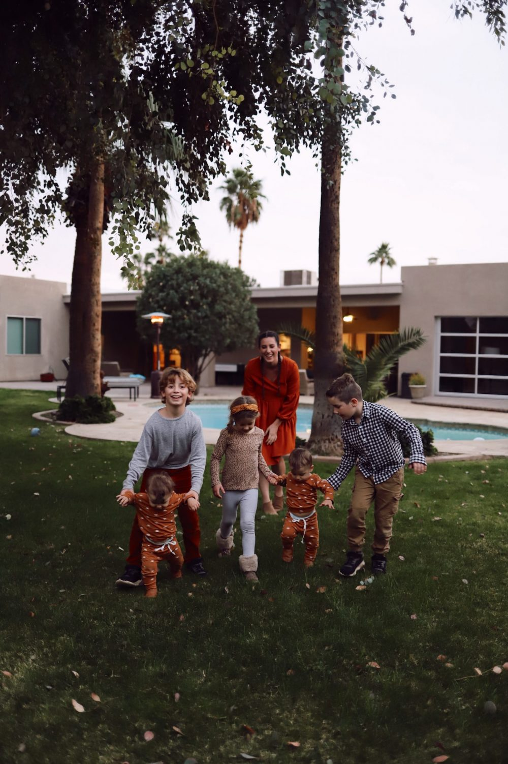 One of the Best Secret Winter Sun Destinations, Scottsdale Arizona. Family-friendly property rental at Bella's Villa Voltaire. |Guide by popular Florida travel blog, Fresh Mommy Blog: image of a family standing outside at Bella's Villa Voltaire.