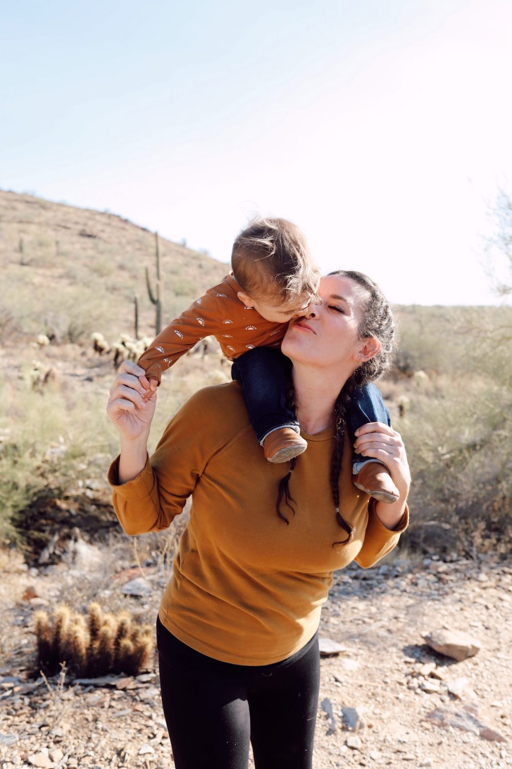 One of the Best Secret Winter Sun Destinations, Scottsdale Arizona. Hiking in the McDowell Sonoran Preserve |Guide by popular Florida travel blog, Fresh Mommy Blog: image of a family hiking in the McDowell Sonoran Preserve.